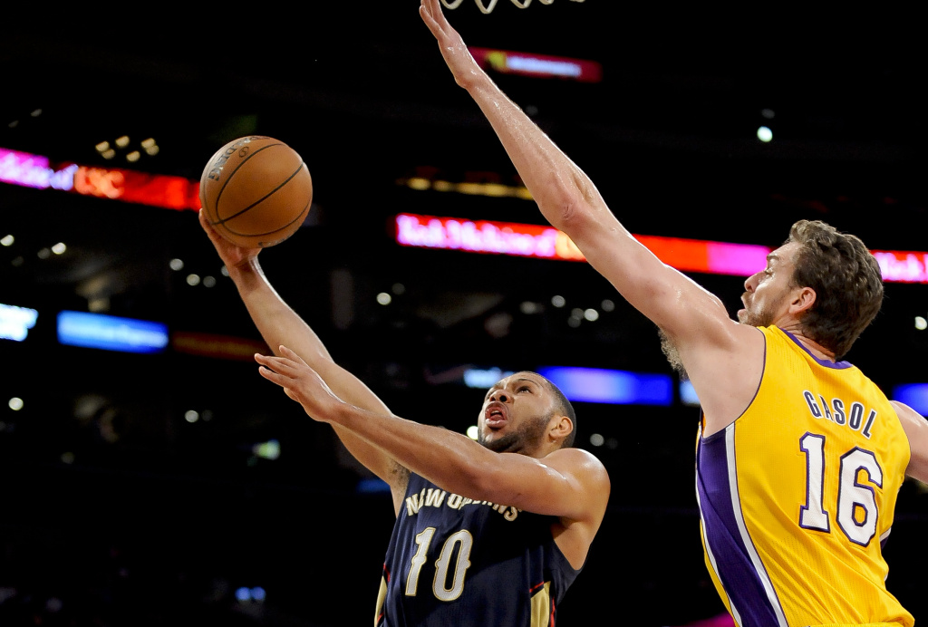 New Orleans Pelicans guard Eric Gordon (10) gets by Los Angeles Lakers center Pau Gasol (16) on a fast break for a basket in the first half of an NBA basketball game, Tuesday, March 4, 2014, in Los Angeles.