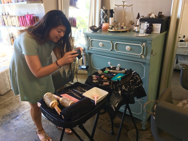Olivia Ku takes photos and video of her appointment at Framed Salon.