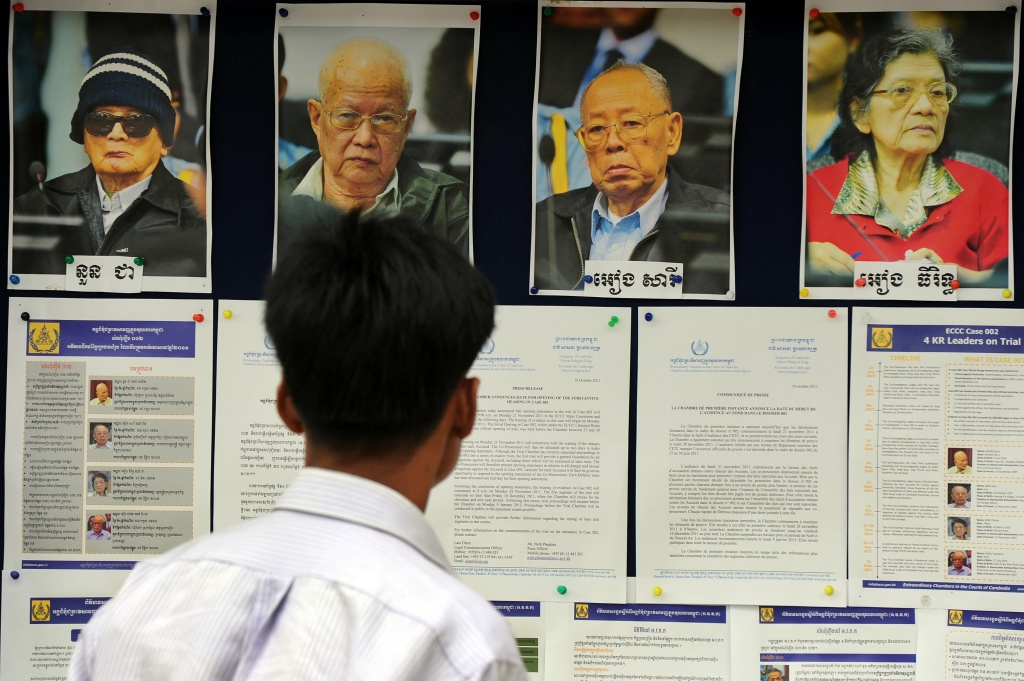 A Cambodian man looks at pictures of former Khmer Rouge leader