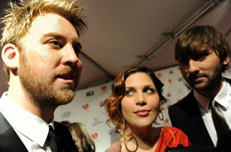 Musicians Charles Kelley (R), Hillary Scott (C) and Dave Haywood of group Lady Antebellum arrive for the Musicares Person of the Year Dinner honoring Neil Young, in Los Angeles, on Jan. 29, 2010.