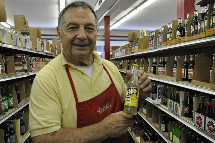 Owner of Galco's Old World Grocery, John Nese, holds a bottle of Lemmy, a lemonade soda— one of his top five choices for refreshing summer sodas.