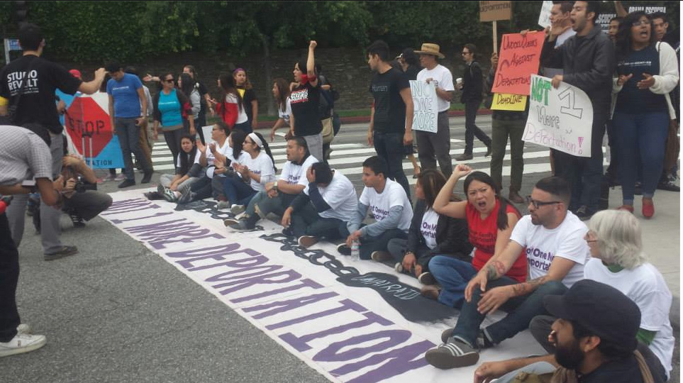 A photo posted to Facebook from Friday's immigrant rights protest in Santa Monica, where police said several protesters were arrested after blocking an intersection along President Obama's motorcade route.