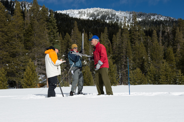 California Department of Water Resources Chief Snow Surveyor Frank Gehrke along with United States Geological Surveyor Frank Anderson walk out for the first media snow survey for the 2015/2016 season.