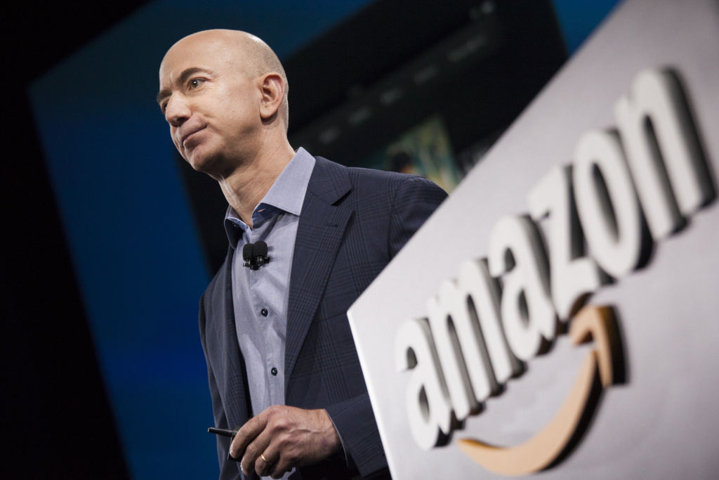 SEATTLE, WA - JUNE 18: Amazon.com founder and CEO Jeff Bezos presents the company's first smartphone, the Fire Phone, on June 18, 2014 in Seattle, Washington.