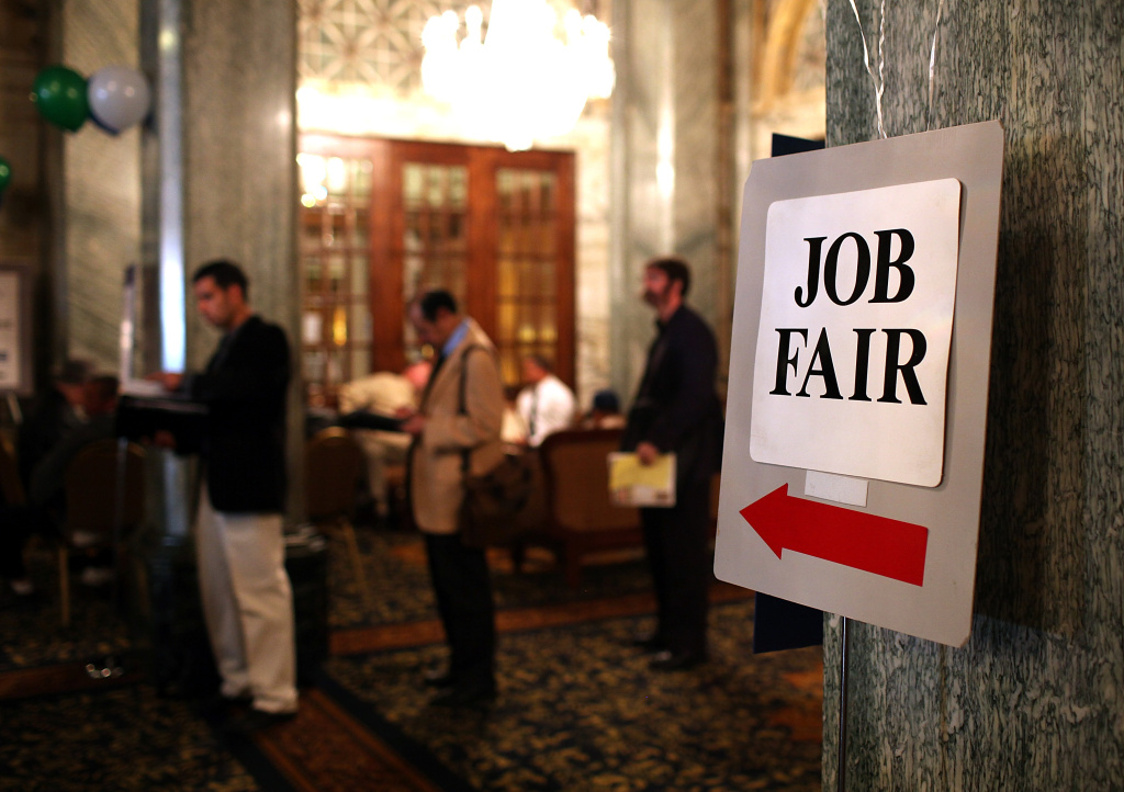 Job seekers wait in line to enter a recent job fair in San Francisco, California.