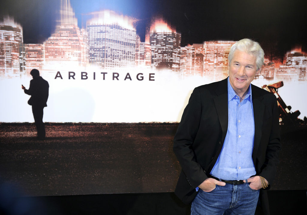 Richard Gere poses during a photocall for the movie Arbitrage on December 4, 2012 in Paris.