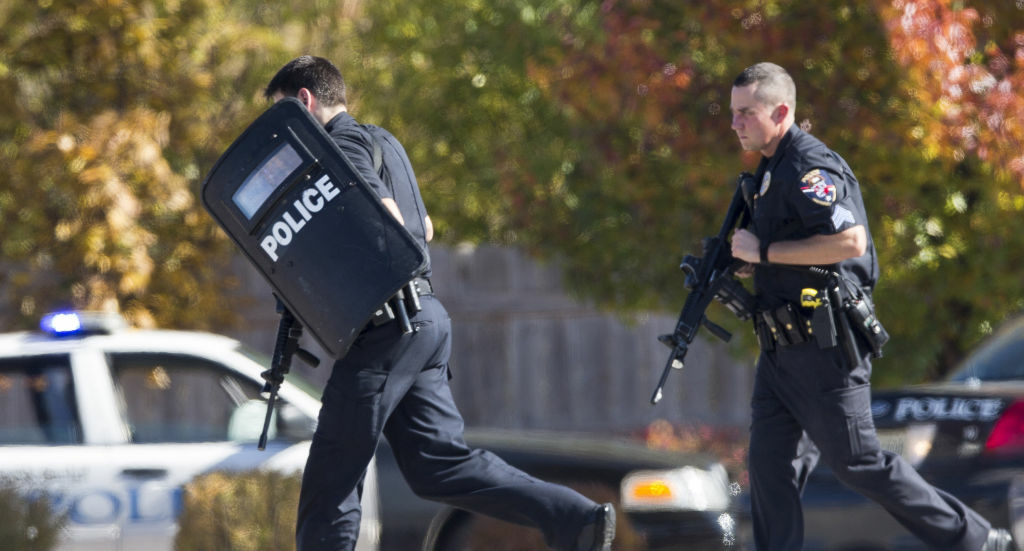 Police and swat team members respond to a call of a shooting at the Azana Spa in Brookfield, Wis.  Sunday,Oct. 21, 2012.  Deputies are still looking for the gunman.