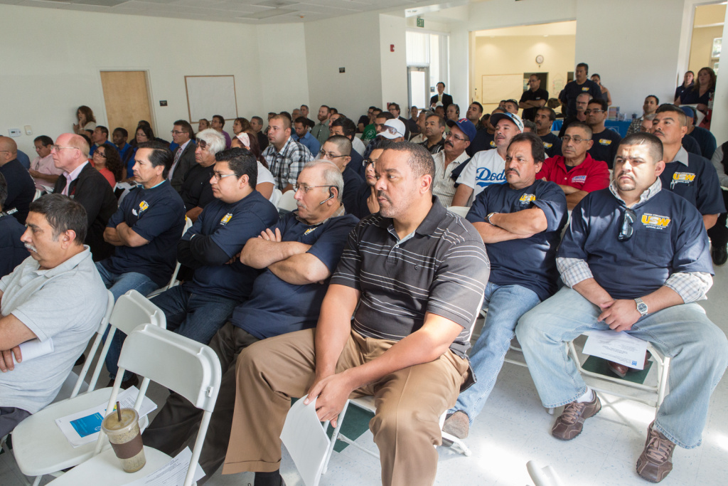 Community members including employees for Exide Technologies attend a meeting at the Huntington Park Community Center about air pollution from the Vernon, Calif. plant. (May 30th, 2013)