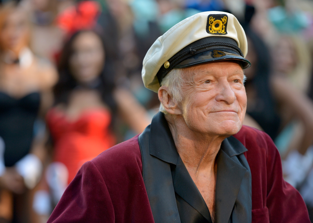 Hugh Hefner poses at Playboy's 60th Anniversary special event on January 16, 2014 in Los Angeles, California.