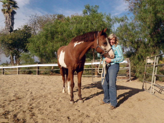 Jan Spak of Santa Monica boards her horse