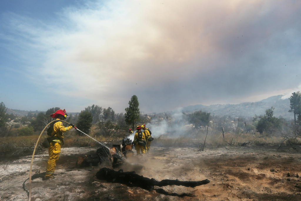 IDYLLWILD, CA - JULY 26:  Firefighters work as the Cranston Fire burns in San Bernardino National Forest on July 26, 2018 near Idyllwild, California. Fire crews are battling the 4,700-acre fire in the midst of a heat wave.  (Photo by Mario Tama/Getty Images)