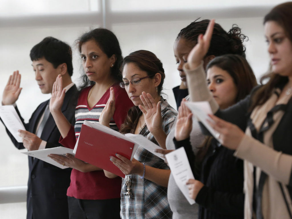 Immigrants take the U.S. oath of citizenship during a naturalization ceremony in Irving, Texas.