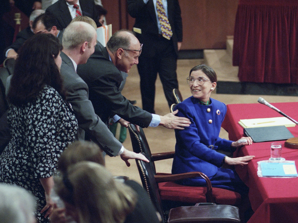 Then-Supreme Court nominee Ruth Bader Ginsburg greets her husband, Martin, during her confirmation hearing in 1993. She didn't hesitate to answer questions about <em>Roe v. Wade</em> and other topics<em> </em>she considered settle law.