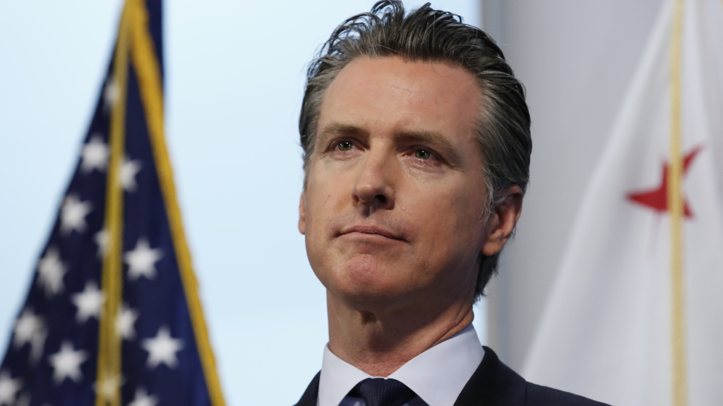 Gov. Gavin Newsom, pictured on Monday, says California has reduced a backlog of testing. The state is asking for contributions of medical supplies with a new website.