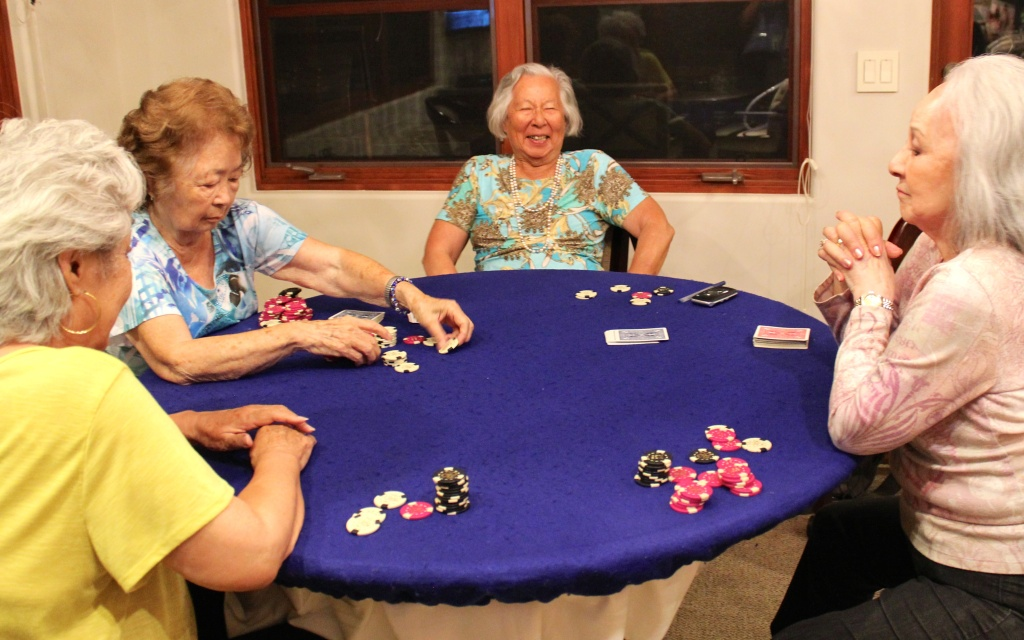 Several members of Just Us Girls try to meet every couple months for dinner and poker night at the Pasadena home of fellow member Sumi Hughes.