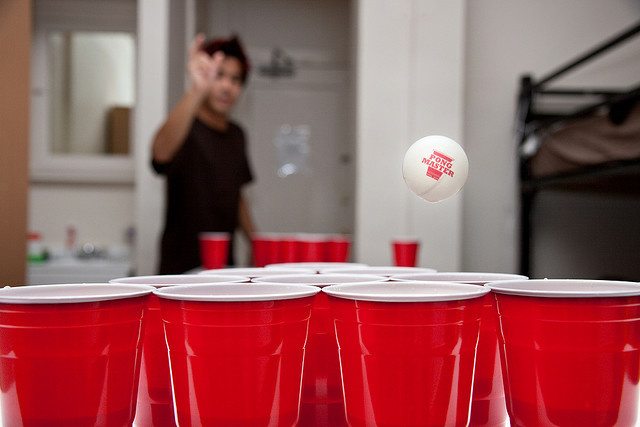 A game of beer pong, a drinking game. Bud Light was shown to be the alcohol of choice among underage drinkers in a recent survey.