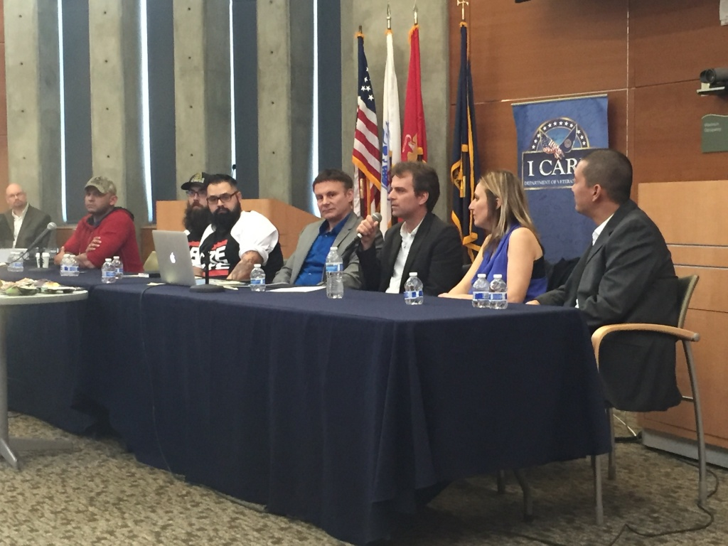 Former Marine sergeant Christian Ellis (in red, to left) and librettist Heather Raffo (second from right) participate in a panel discussion at the VA hospital in Long Beach, Calif. about their upcoming opera 'Fallujah.'