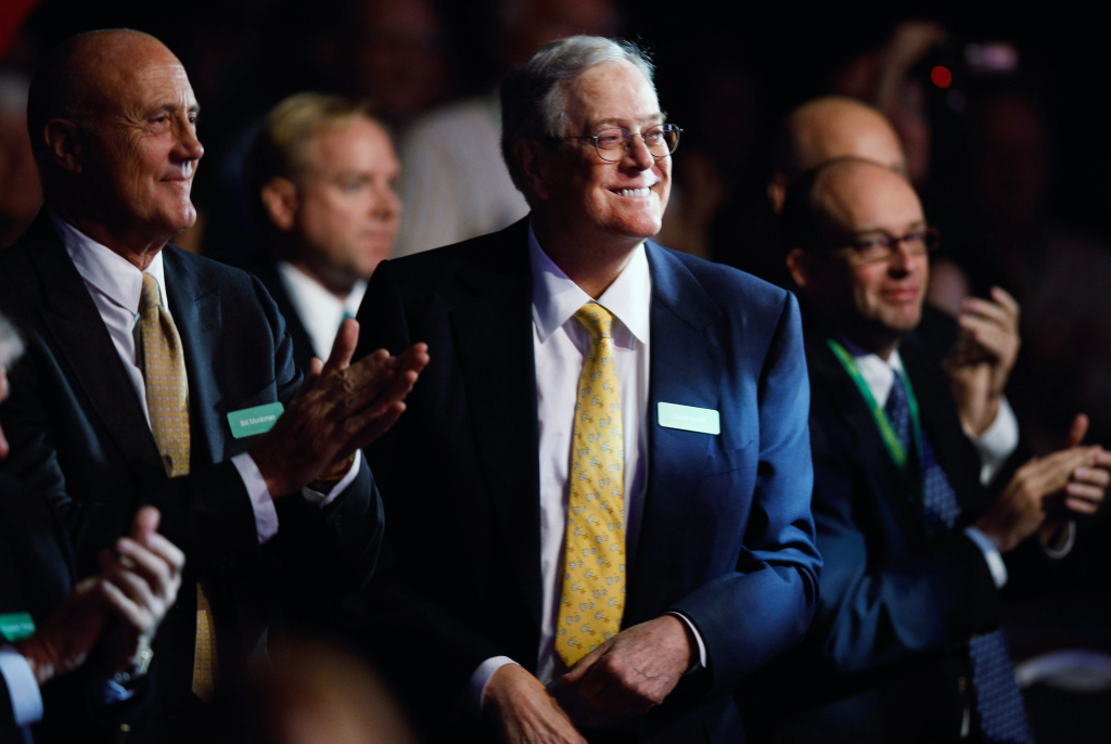 Americans for Prosperity Foundation chairman and  Koch Industries Executive Vice President David H. Koch (C) listens to speakers during the Defending the American Dream Summit at the Washington Convention Center November 4, 2011 in Washington, DC. The conservative political summit is organized by Americans for Prosperity, which was founded with the support of Koch.