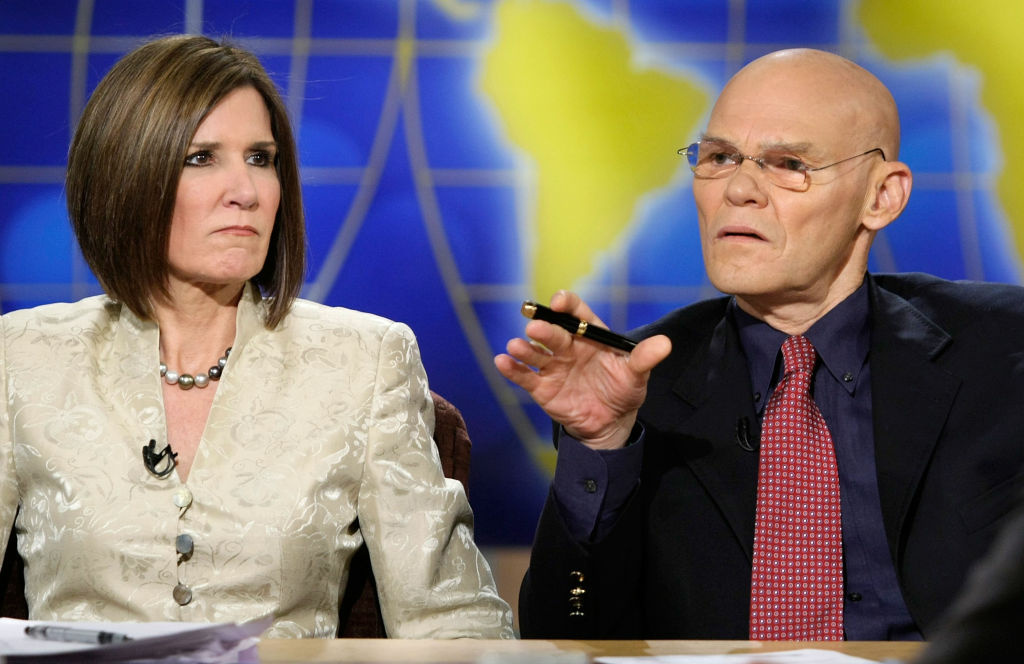 Democratic strategist James Carville (R) speaks as his wife and Republican strategist Mary Matalin (L) listens during a taping of