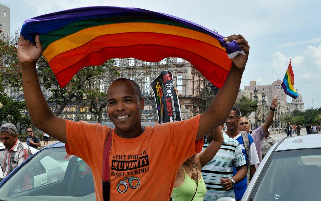 Cubans march along Prado Boulevard in Havana, on June 28, 2011, to celebrate the Gay Pride Day.