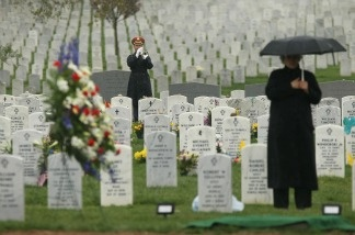A bugler plays the 'Taps' during the funeral of U.S. Army Air Forces Tech. Sgt. James G. Maynard April 22, 2011 at Arlington National Cemetery in Arlington, VA.