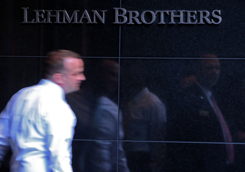 File: Lehman Brothers employee leaves the building in New York.