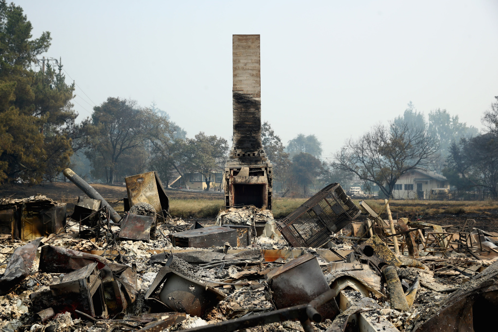 A view of the remains of homes that were destroyed by the Atlas Fire on October 10, 2017 in Napa, California.  Fifteen people have died in wildfires that have burned tens of thousands of acres and destroyed over 2,000 homes and businesses in several Northern California counties.