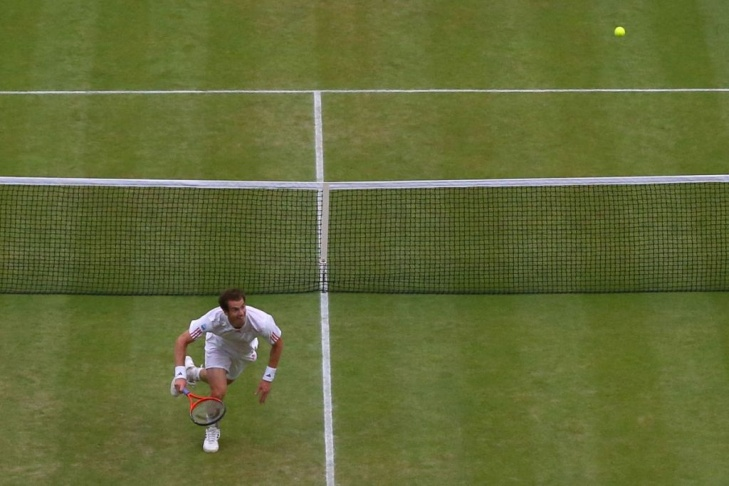 Switzerland's Roger Federer falls to his knees in celebration after his men's singles final victory over Britain's Andy Murray on day 13 of the 2012 Wimbledon Championships tennis tournament at the All England Tennis Club in Wimbledon, southwest London, on July 8, 2012.