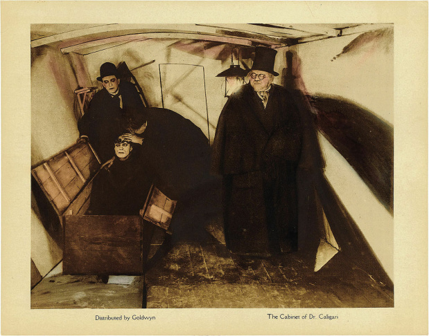 Lobby Card from the 1920 film 'The Cabinet of Dr. Caligari' as doctors examine his somnambulist, Cesare. This is the only card with Caligari and Cesar together.