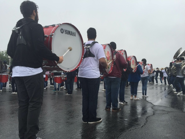 Students spent hours practicing in the rain outside of Dodger Stadium to prepare for the Rose Parade .