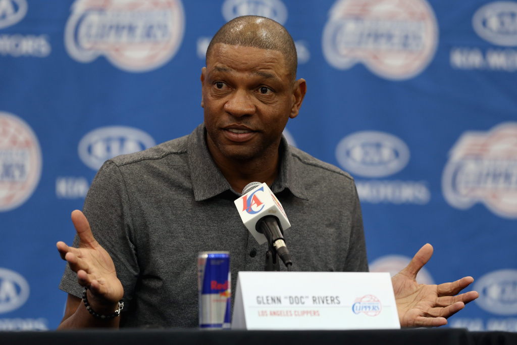 File photo: Doc Rivers addresses the media after being introduced as the new head coach and senior vice president of basketball operations of the Los Angeles Clippers during a press conference at the Los Angeles Clippers training center on June 26, 2013 in Playa Vista, California. On Tuesday, the team's interim CEO testified in court that Rivers told him he would quit if Donald Sterling remained as owner.
