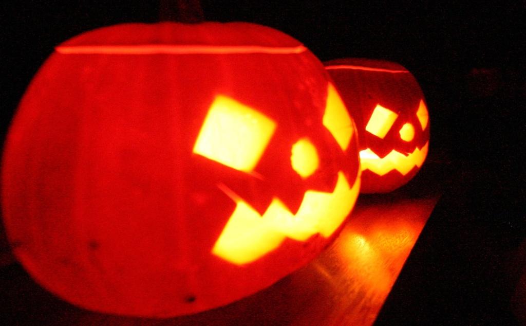 Candle-lit Halloween pumpkins.