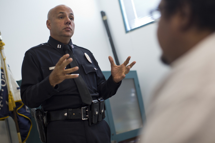 LAPD Captain Jorge Rodriguez, left, talks with Adela Barajas, founder of Life After Uncivil Ruthless Acts, during a monthly community meeting at LAPD's Newton station on Thursday, Feb. 5.