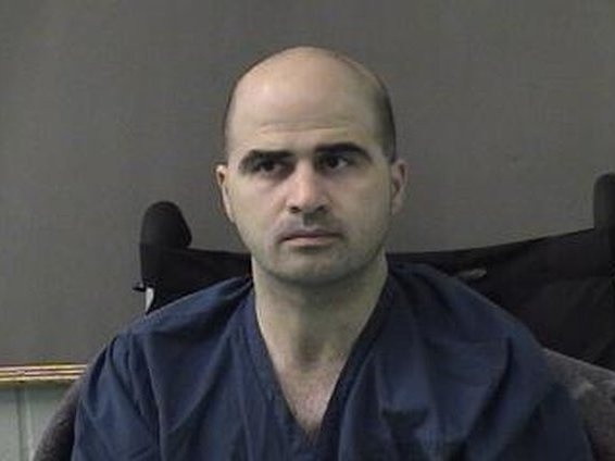 In this photo released by the Bell County Sheriff's Office, U.S. Maj. Nidal Hasan is seen in a booking photo after being moved to the Bell County Jail on April 9, 2010 in Belton, Texas.