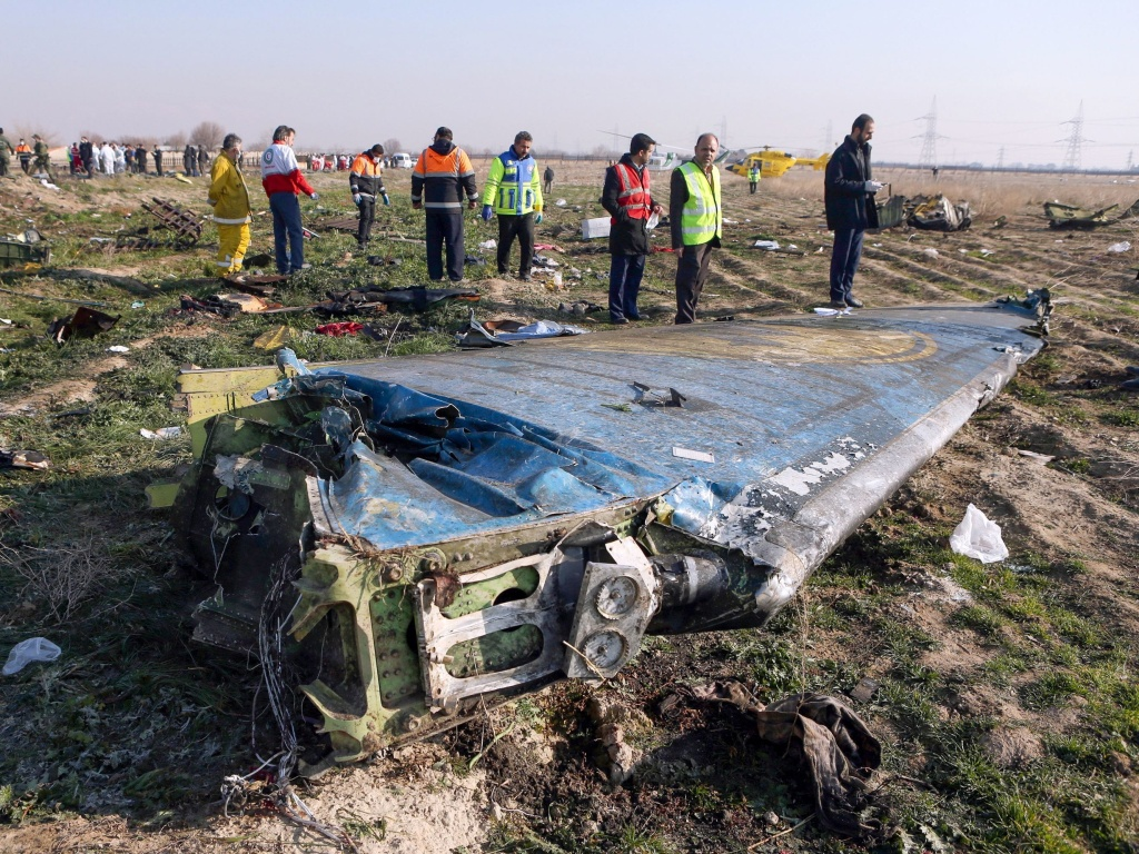 Rescue teams examine the wreckage of a Ukrainian airliner shot down shortly after take-off in the Iranian capital Tehran on Jan. 8. Iran says a tragic series of mistakes led to the missile strike.