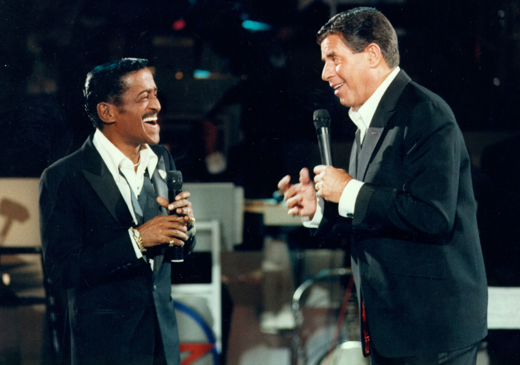 Jerry Lewis (R) performs with Sammy Davis Jr. (L) during the 1976 telecast of The Jerry Lewis MDA Telethon.