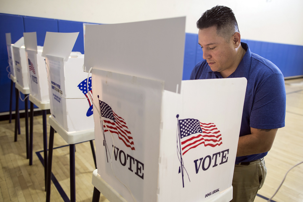 FILE PHOTO: Felix Martinez of El Sereno votes at a polling place inside Barrio Action Youth & Family Center on during the California primary election.