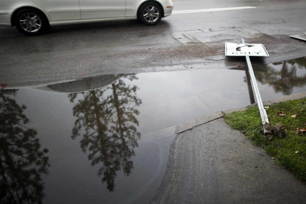 A street sign on Coldwater Avenue in Studio City is knocked over on Friday, Feb. 28 after an overnight rainstorm in Southern California.