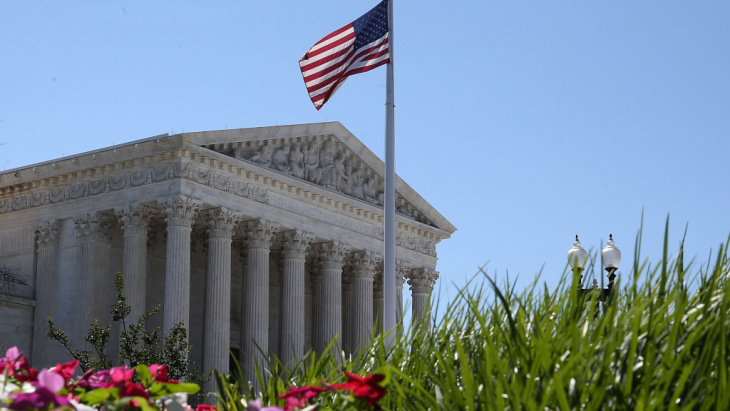An American flag flies over the Supreme Court in June.