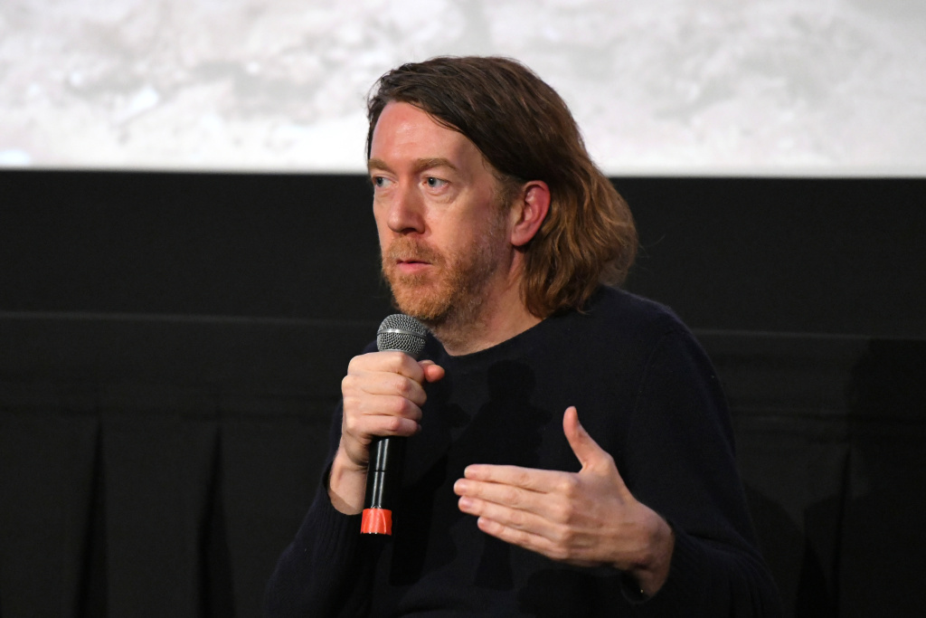 Director Chris Smith speaks on stage during Q&A session after New York screening of Netflix's