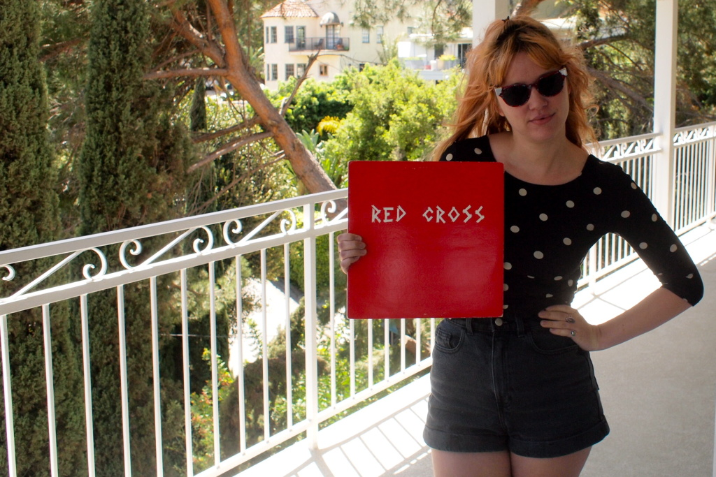 Jennifer Clavin, singer and guitarist in Bleached holds a copy of Red Cross' debut EP.