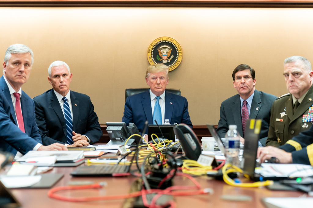 In this handout photo provided by the White House, President Donald J. Trump, Vice President Mike Pence (2nd L), National Security Advisor Robert O'Brien (L), Secretary of Defense Mark Esper (2nd R) and Chairman of the Joint Chiefs of Staff U.S. Army General Mark A. Milley monitor incoming developments as U.S. Special Operations forces close in on ISIS leader Abu Bakr al-Baghdadi's compound in Syria on October 26, 2019