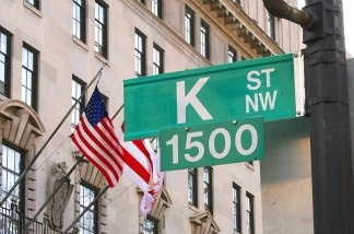 A sign showing K Street is shown in Washington,DC. A stone's throw from the White House, K Street is an alternative corridor of power in US politics, packed with thick carpeted offices and lobbyists with even deeper pockets.