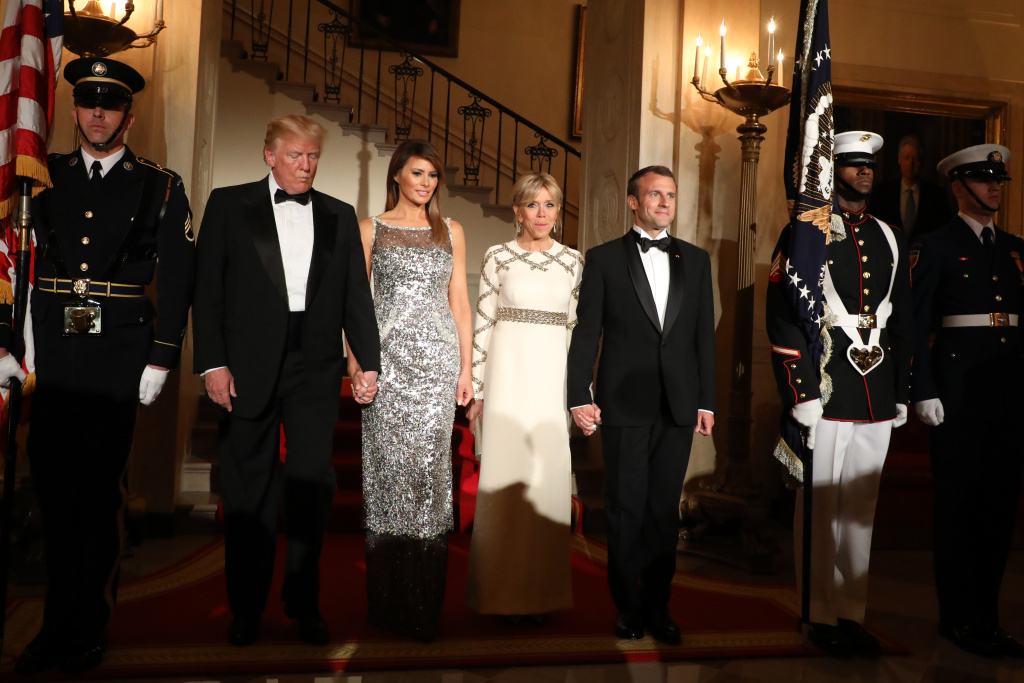 US President Donald Trump and First Lady Melania Trump arrive with French President Emmanuel Macron and his wife, Brigitte Macron, for a State Dinner in the White House in Washington, DC, April 24, 2018.