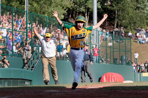 Eric Anderson of the West team from Huntington Beach celebrates as he prepares to score the winning run against the Japan team in the Little League Word Series championship game on August 28, 2011.