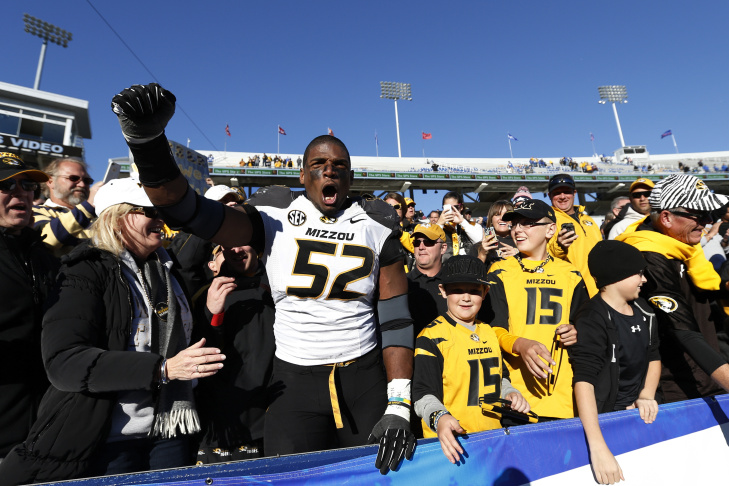 Defensive lineman Michael Sam #52 then of the Missouri Tigers reacts to an interception during the Insight Bowl against the Iowa Hawkeyes at Sun Devil Stadium on December 28, 2010 in Tempe, Arizona.