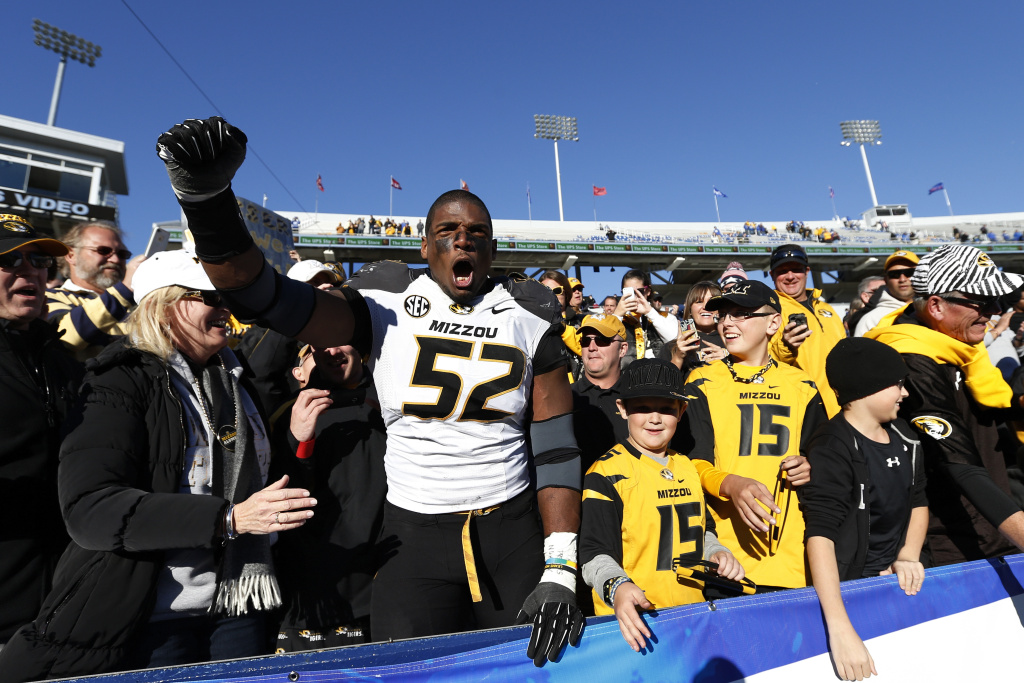 Michael Sam #52 of the Missouri Tigers celebrates with fans after the game against the Kentucky Wildcats at Commonwealth Stadium on November 9, 2013 in Lexington, Kentucky. Missouri won 48-17.