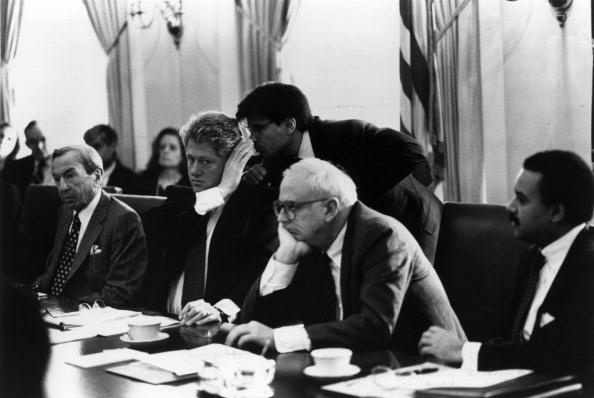 When you have had the ear of the President ... US President Bill Clinton receives a last-minute briefing from aide George Stephanopoulos during a meeting at the White House. US Secretary of State Warren Christopher is at the eft.