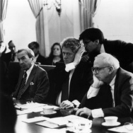 1993: Bill Clinton, the 42nd president of the United States (second from left) receives a last minute briefing from aide, George Stephanopoulos, during a meeting at the White House, Washington DC.