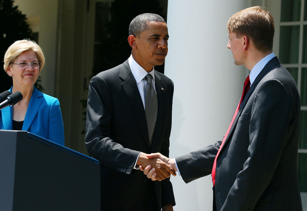 WASHINGTON, DC - JULY 18:  U.S. President Barack Obama  (C) shakes hands with former Ohio Attorney General Richard Cordray during a presser to announce the nomination of Cordray as head of the in the Consumer Financial Protection Bureau as Special Advisor on the Consumer Financial Protection Bureau Elizabeth Warren (L) watches in the Rose Garden at the White House on July 18, 2011 in Washington, DC. The new bureau was created under a reform bill last year and intends to make basic financial practices such as taking out a mortgage or loan more clear and transparent to consumers while weeding out unfair lending practices.  (Photo by Mark Wilson/Getty Images)